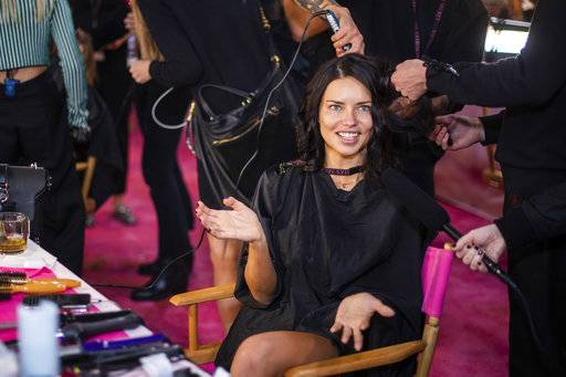 Adriana Lima appears backstage during hair and makeup at the 2018 Victoria's Secret Fashion Show at Pier 94 on Thursday, Nov. 8, 2018, in New York. (Photo by Charles Sykes/Invision/AP)