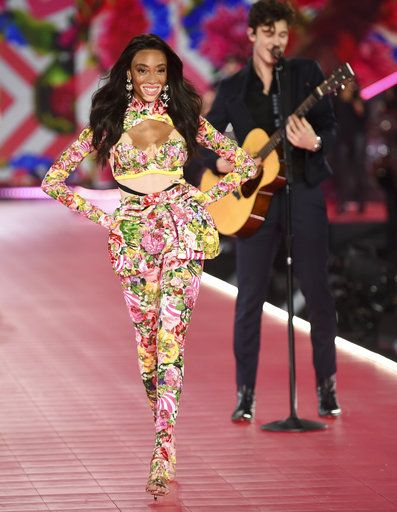 Winnie Harlow, left, walks the runway as Shawn Mendes performs during the 2018 Victoria's Secret Fashion Show at Pier 94 on Thursday, Nov. 8, 2018, in New York. (Photo by Evan Agostini/Invision/AP)