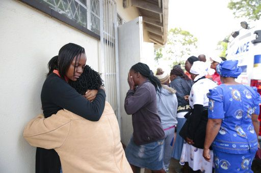 People react after hearing news about their relatives, after a bus crash in Rusape about 170 kilometres east of the capital Harare, Thursday, Nov.  8, 2018. A head-on collision between two buses has killed 47 people, where road accidents are common due to poor roads and bad driving.