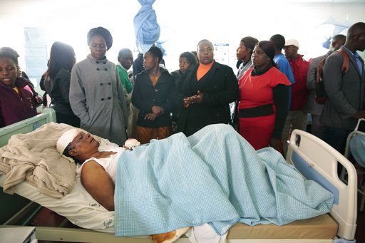 A woman who survived a bus crash receives treatment in Rusape about 170 kilometres east of the capital Harare, Thursday, Nov.  8, 2018. A head-on collision between two buses has killed 47 people, where road accidents are common due to poor roads and bad driving.