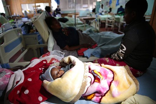 Klavan Munyisa who is 3 months old  lays in a hospital bed after surviving a bus crash in Rusape about 170 kilometres east of the capital Harare, Thursday, Nov. 8, 2018. A head-on collision between two buses has killed 47 people, where road accidents are common due to poor roads and bad driving.
