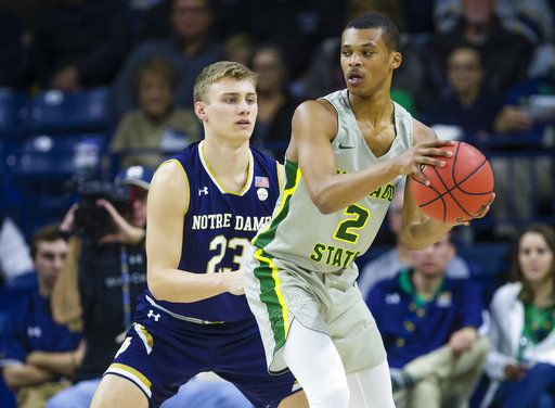 Chicago State's Delshon Strickland (2) works against Notre Dame's Dane Goodwin (23) during an NCAA college basketball game Thursday, Nov. 8, 2018, in South Bend, Ind. (Michael Caterina/South Bend Tribune via AP)