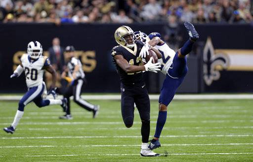 FILE - In this Nov. 4, 2018, file photo, New Orleans Saints wide receiver Michael Thomas (13) pulls in a pass against Los Angeles Rams cornerback Marcus Peters (22) during the first half of an NFL football game in New Orleans. Peters criticized himself for playing poorly when the Rams took their first loss of the season at New Orleans last weekend. That doesn't mean Saints coach Sean Payton can say anything about it, however. Peters reacted sharply in the Rams' locker room Thursday, Nov. 8, when asked about postgame comments by Payton in which the veteran coach said the Saints liked the matchup of receiver Michael Thomas going against Peters, a former Pro Bowl selection.