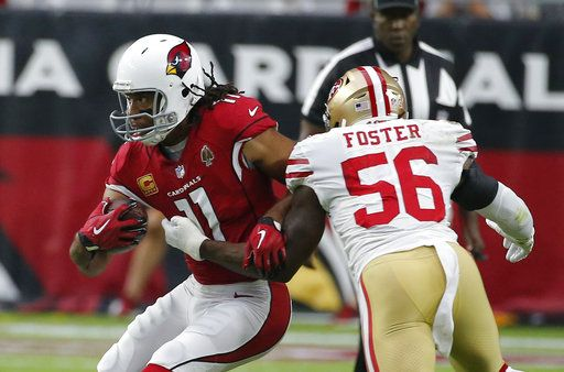 FILE - In this Oct. 28, 2018, file photo, Arizona Cardinals wide receiver Larry Fitzgerald (11) runs with the ball during the team's NFL football game against the San Francisco 49ers in Glendale, Ariz. Fitzgerald is closing in on another milestone, and it's an impressive one. The 35-year-old receiver needs to catch just 33 yards of passes Sunday at Kansas City to move past Hall of Famer Terrell Owens into second place in the NFL's all-time yards receiving list.