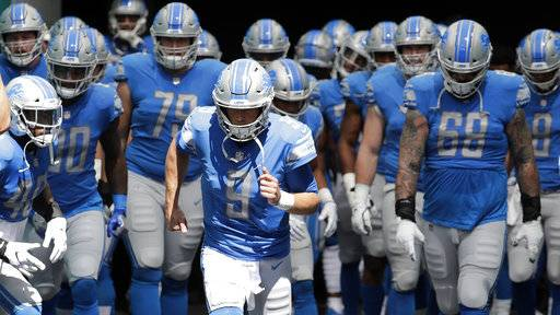 FILE - In this Oct. 21, 2018, file photo, Detroit Lions quarterback Matthew Stafford (9) leads his teammates onto the field for an NFL football game against the Miami Dolphins in Miami Gardens, Fla. The Chicago Bears have a rare opportunity to beat the Detroit Lions and pick up a victory over an NFC North opponent when the two teams meet at Soldier Field on Sunday.