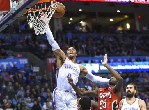 Oklahoma City Thunder guard Russell Westbrook (0) puts up a shot over New Orleans Pelicans forward E'Twaun Moore (55) in the second half of an NBA basketball game in Oklahoma City, Monday, Nov. 5, 2018.