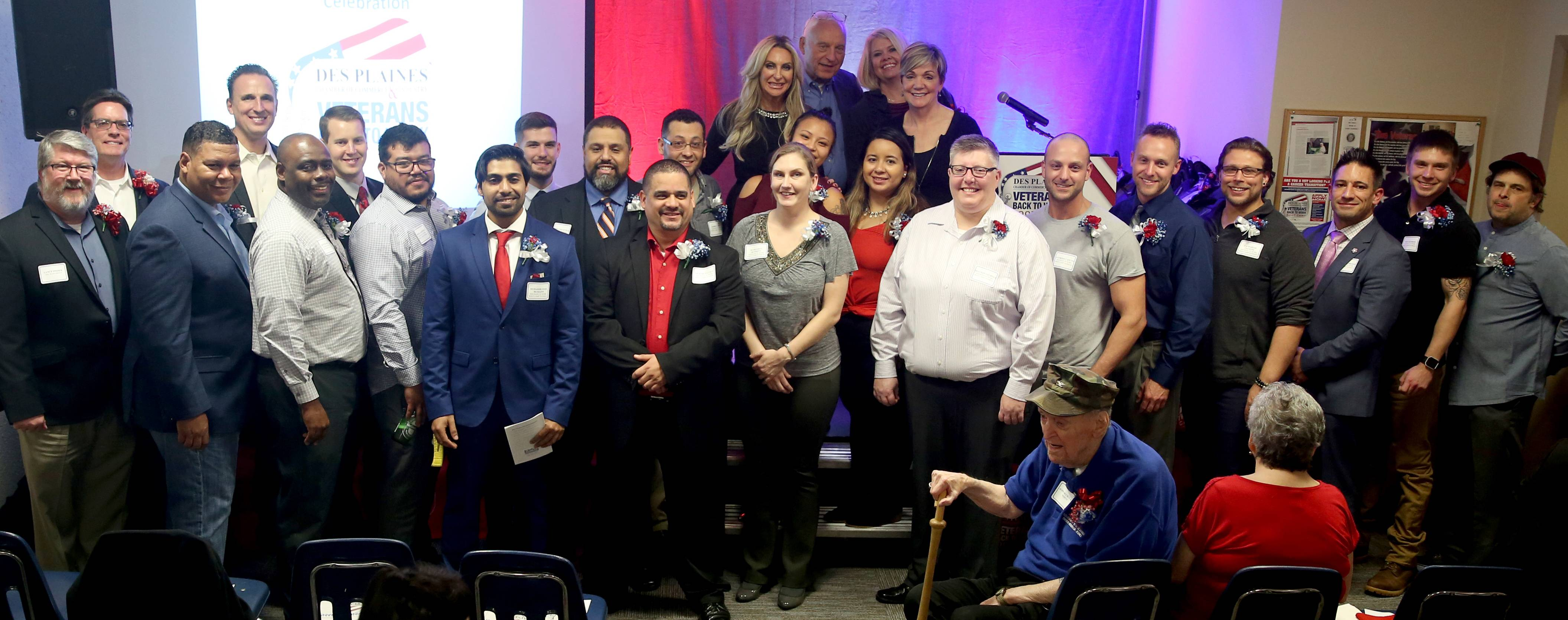 Graduates and distinguished guests pose for a group photo during the Des Plaines Chamber of Commerce & Industry Veterans Back to Work Boot Camp graduation ceremony at Des Plaines American Legion Post 36 on Thursday night.