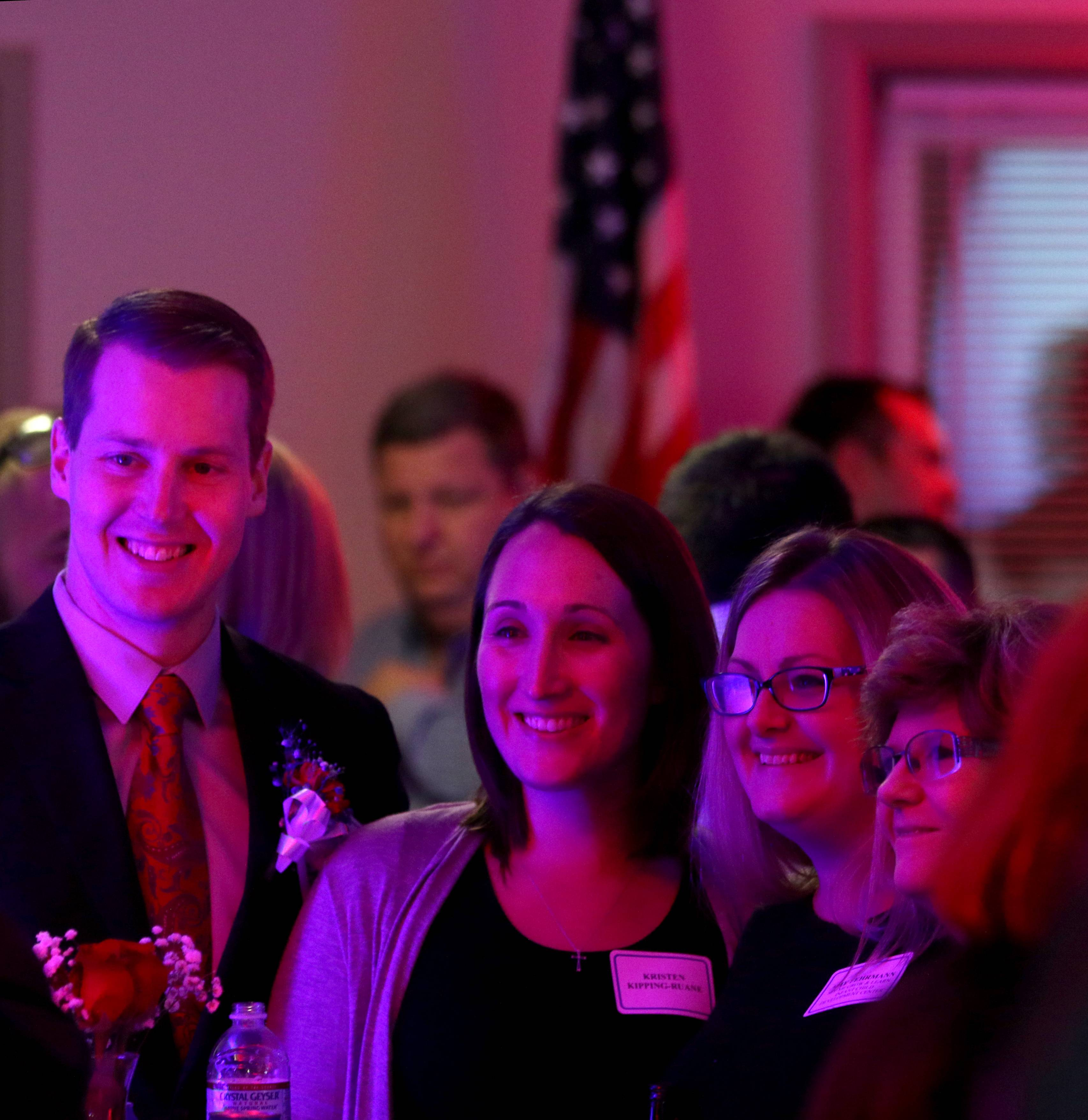 Colin Patrick Kipping-Raune, left, of Western Springs mingles with others during the Des Plaines Chamber of Commerce & Industry Veterans Back to Work Boot Camp graduation ceremony at Des Plaines American Legion Post 36 on Thursday night. Kipping-Raune was honored as a graduate of the program.