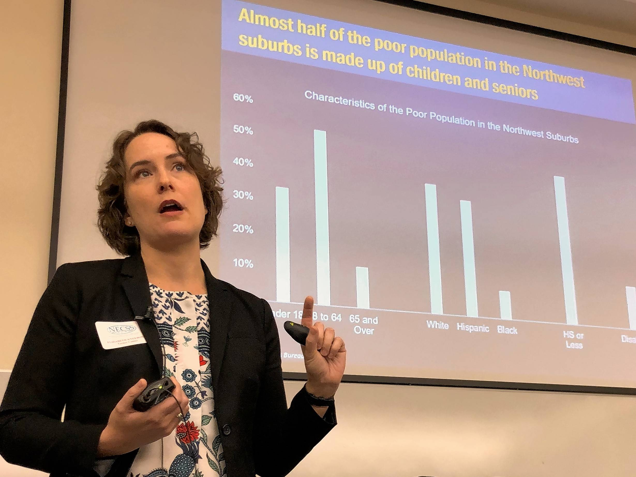 Researcher Elizabeth Kneebone speaks Friday at Harper College about the impact of poverty on students and families in the suburbs and nationally.