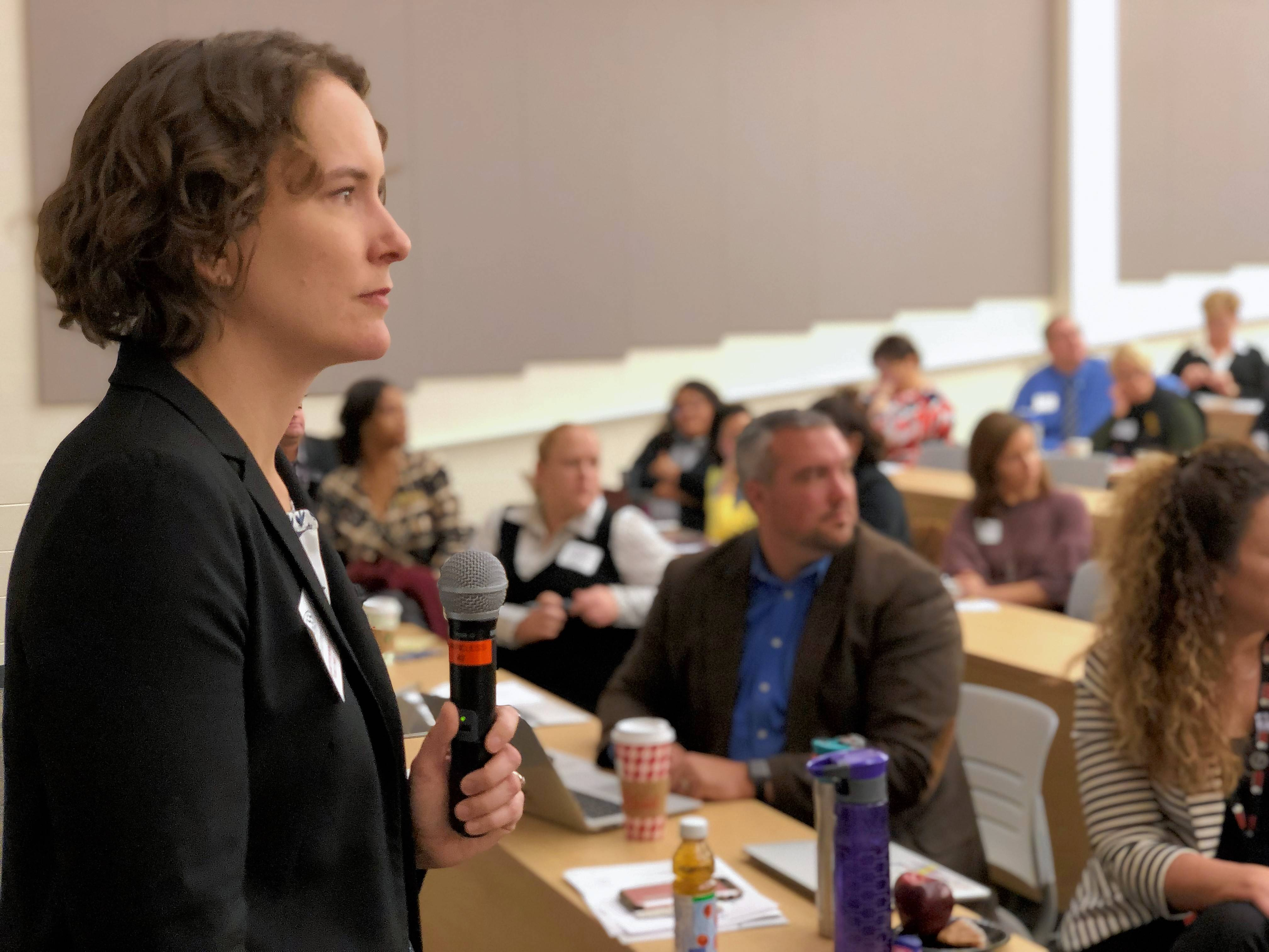 Researcher Elizabeth Kneebone takes questions Friday from suburban educators and community leaders during a program at Harper College in Palatine about the impact of poverty in the suburbs.