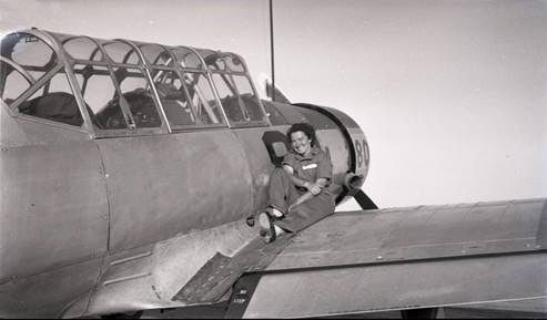 Janice Christensen on the wing of an airplane during World War II.