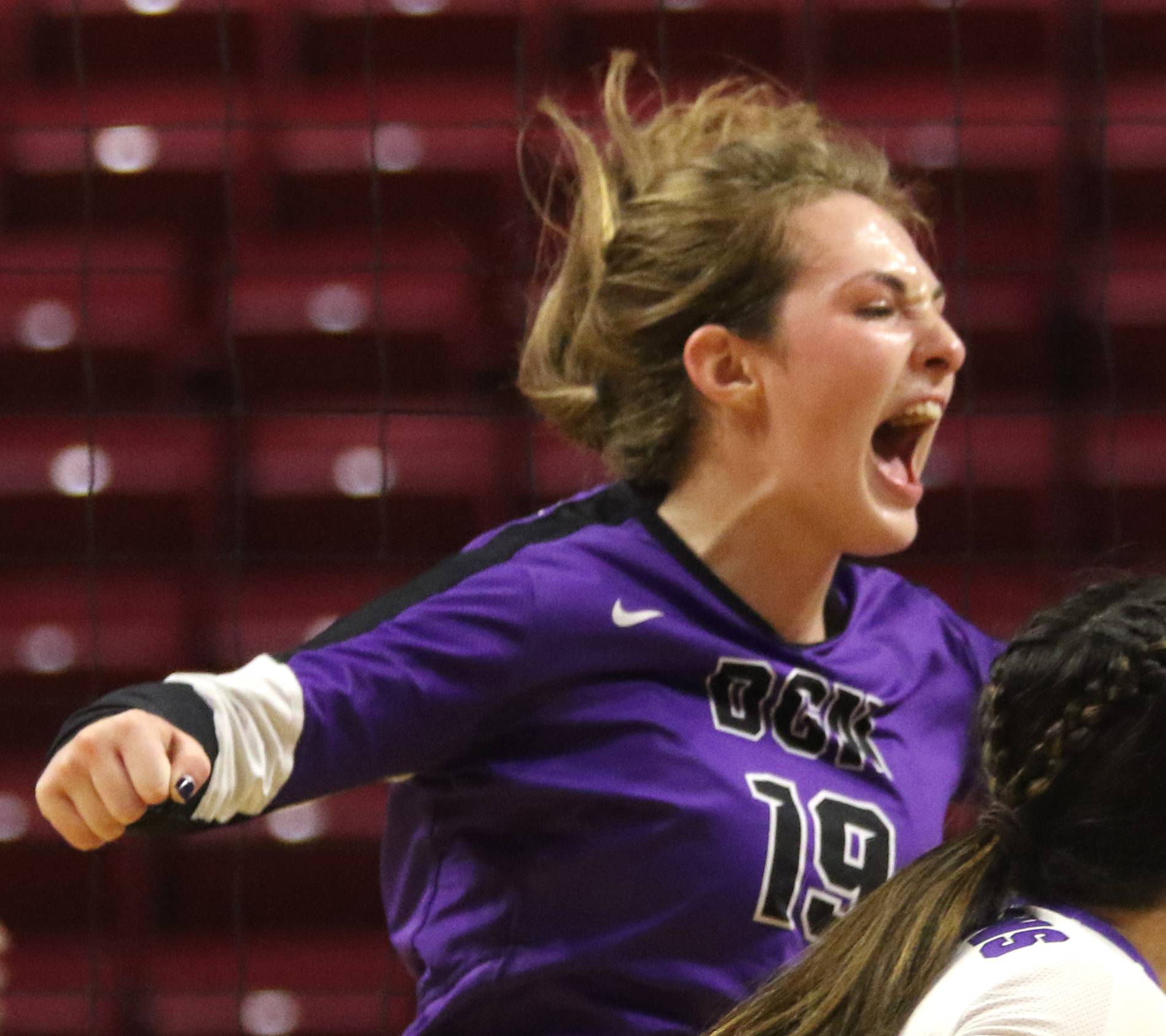Downers Grove North's Jade Casper celebrates a point during Class 4A girls state semifinal volleyball action at Redbird Arena on the campus of Illinois State University Friday night.