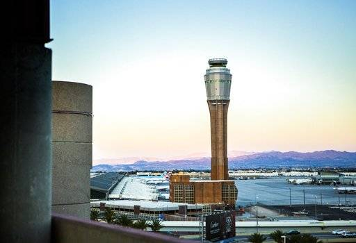 "FILE - This Aug. 6, 2014 file photo shows the news FAA tower under construction at McCarran International Airport in Las Vegas. Federal and airport authorities said Friday, Nov. 9, 2018, they are investigating why an air traffic controller became incapacitated and went silent while working a night shift alone in the tower at busy McCarran International Airport in Las Vegas. ""No safety events occurred during this incident,"" the Federal Aviation Administration said in a statement about what officials said amounted to a 40-minute span during which the female controller slurred words and then apparently lost consciousness shortly before midnight Wednesday. (Jeff Scheid/Las Vegas Review-Journal via AP, File)"