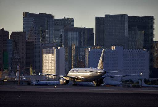 FILE - In this May 16, 2016, photo, a plane taxis toward the terminal after landing at McCarran International Airport in Las Vegas. Federal and airport authorities said Friday, Nov. 9, 2018, they are investigating why an air traffic controller became incapacitated and went silent while working a night shift alone in the tower at busy McCarran International Airport. Five inbound aircraft remained airborne during the incident, and aircraft on the ground held positions or communicated between themselves to maintain safety while moving, the FAA said.