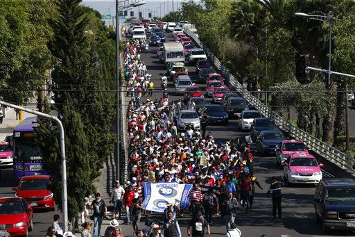 A group of Central American migrants, representing the thousands participating in a caravan trying to reach the U.S. border, undertake an hours-long march to the office of the United Nations' humans rights body in Mexico City, Thursday, Nov. 8, 2018. Members of the caravan which has stopped in Mexico City demanded buses Thursday to take them to the U.S. border, saying it is too cold and dangerous to continue walking and hitchhiking.
