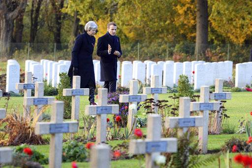 British Prime Minister Theresa May and French President Emmanuel Macron visit the Thiepval cemetery as part of ceremonies to mark the centenary of the 1918 Armistice, in Thiepval, northern France, Friday, Nov. 9, 2018. The memorial commemorates more than 72,000 men of British and South African forces who died in the Somme offensive of 1916. (Eliot Blondet/Pool Photo via AP)