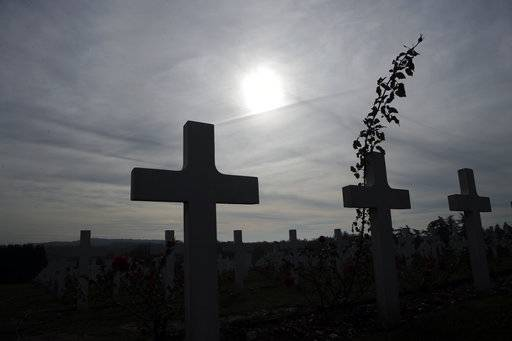 Graves are silhouetted at the cemetery by the Ossuary of Douaumont near Verdun, northeastern France, Tuesday, Nov. 6, 2018 during ceremonies marking the centenary of World War I globe.