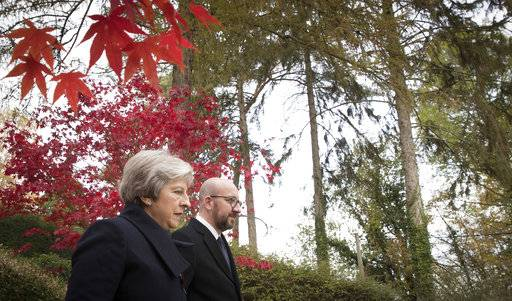 British Prime Minister Theresa May, left, and Belgian Prime Minister Charles Michel walk at the St. Symphorien cemetery in Mons, Belgium, Friday, Nov. 9, 2018. Wreaths were layed at the graves of British World War I soldiers John Parr and George Ellison. (Benoit Doppagne, Pool Photo via AP)