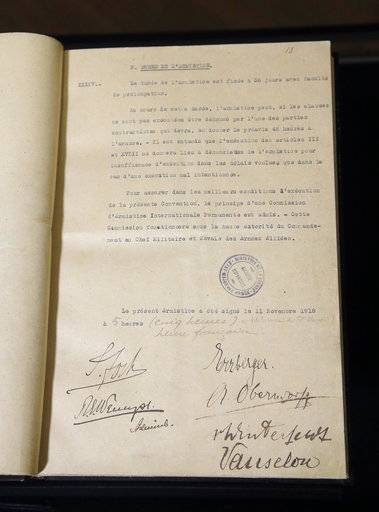 This Tuesday, Oct. 30, 2018 photo shows the Armistice document signed by the Allies and the Germans in a carriage in Rethondes, north of Paris, at 05:00 am on Nov. 11, 1918. The document is displayed at the Vincennes castle museum in Vincennes, outside Paris, France. The Allies signed the Armistice on Nov. 11, 1918 in a train carriage in Compiegne, north of Paris, that ended hostilities with Germany and put an end to the atrocities of World War I.