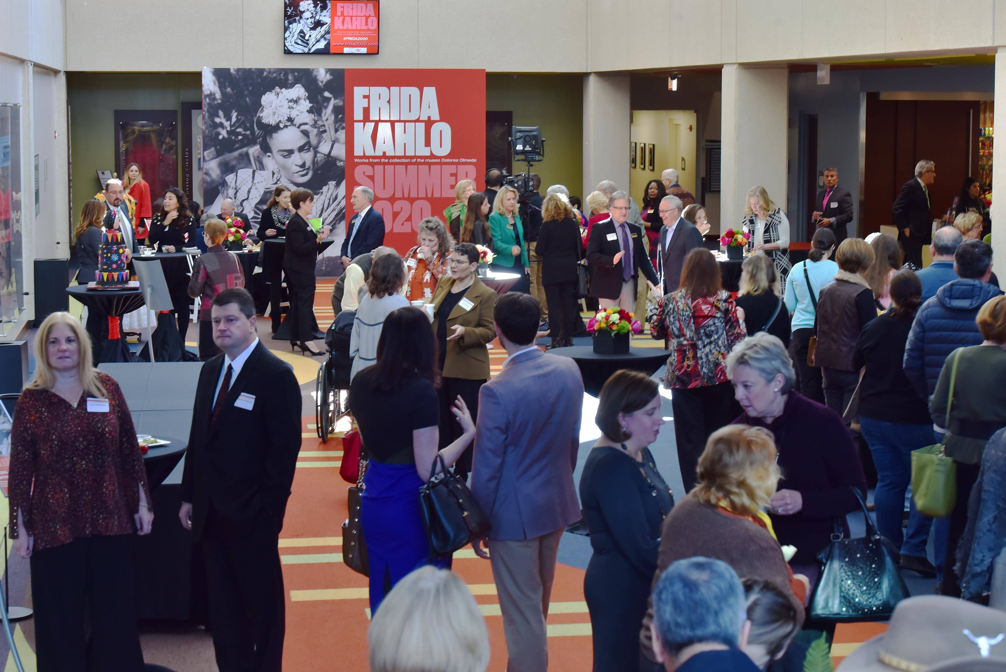 Guests enjoy a reception before the College of DuPage announces plans for a new Frida Kahlo art exhibition at the McAninch Arts Center in Glen Ellyn Saturday.