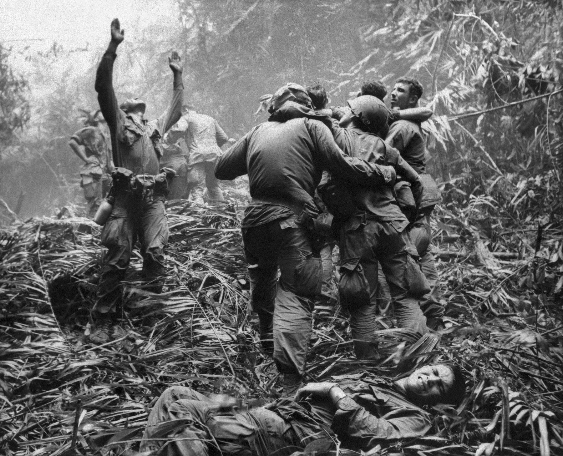 This iconic April 1968 file photo shows the first sergeant of A Company, 101st Airborne Division, guiding a medevac helicopter through the jungle foliage to pick up casualties suffered during a five-day patrol near Hue.