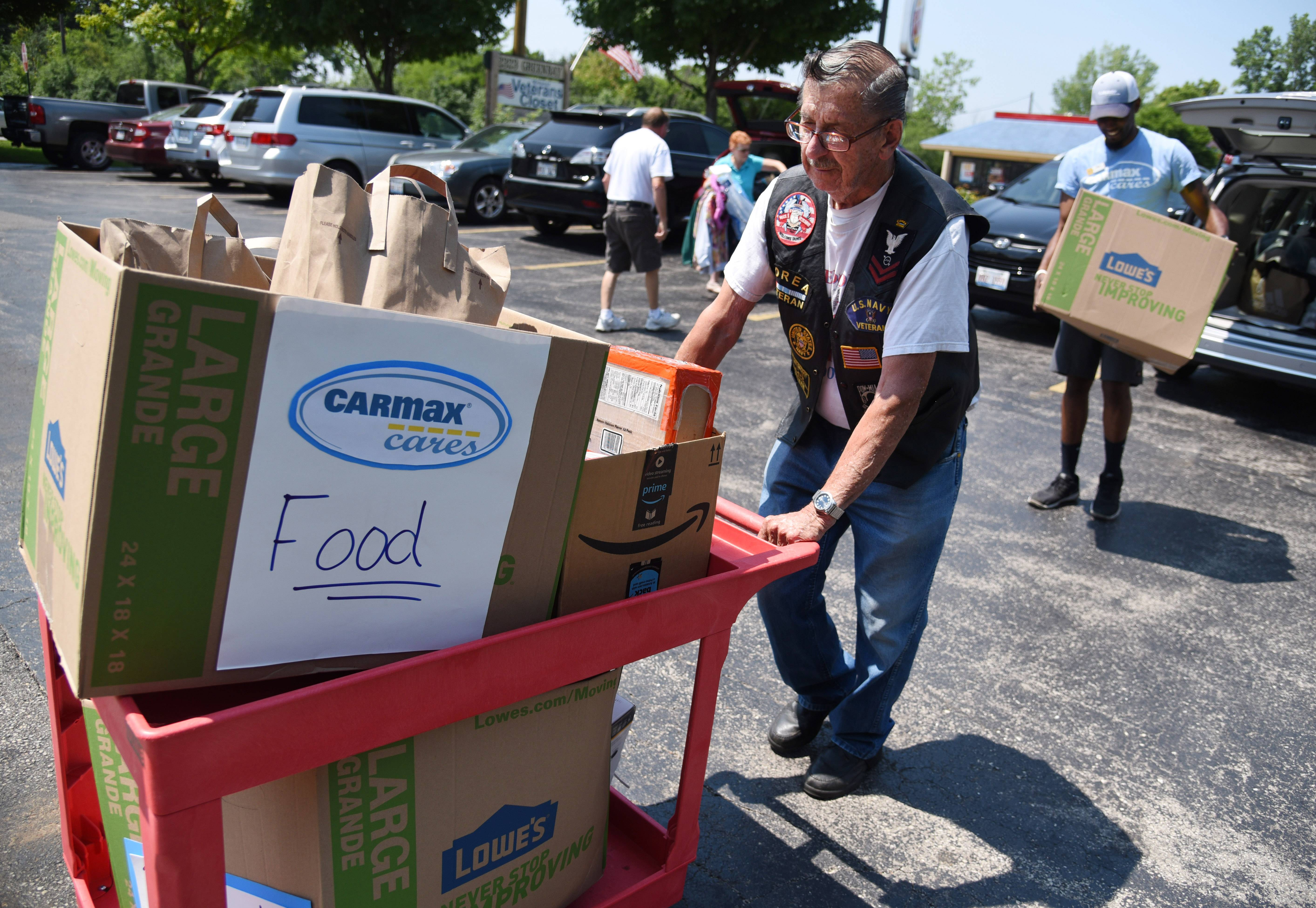 "CarMax employees donated items to the Midwest Veterans Closet in North Chicago, and volunteer Russ ""Pops"" McCann assists with the delivery."