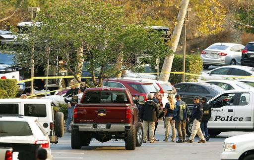 FBI investigators join law enforcement as they work near the scene of Wednesday's shooting in Thousand Oaks, Calif., Friday, Nov. 9, 2018. Investigators continue to work to figure out why an ex-Marine opened fire Wednesday evening inside a country music bar, killing multiple people.