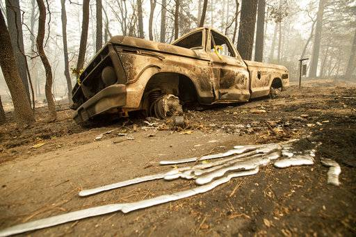 A burned pick-up truck rests on Pearson Rd. after the wildfire burned through Paradise, Calif., on Saturday, Nov. 10, 2018. Not much is left in Paradise after a ferocious wildfire roared through the Northern California town as residents fled and entire neighborhoods are leveled.