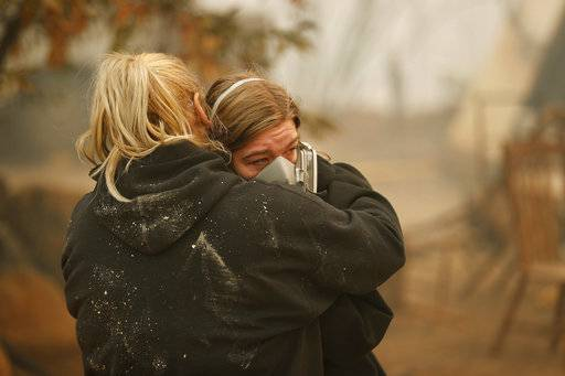 Krystin Harvey, left, comforts her daughter Araya Cipollini at the remains of their home burned in the Camp Fire, Saturday, Nov. 10, 2018, in Paradise, Calif. The blaze that started Thursday outside the hilly town of Paradise has grown and destroyed more than 6,700 buildings, almost all of them homes, making it California's most destructive wildfire since record-keeping began. But crews have made gains and the fire is partially contained, officials said Saturday.
