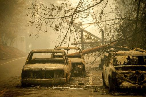 Abandoned cars, scorched by the wildfire, line Pearson Rd. in Paradise, Calif., on Saturday, Nov. 10, 2018. Not much is left in Paradise after a ferocious wildfire roared through the Northern California town as residents fled and entire neighborhoods are leveled.