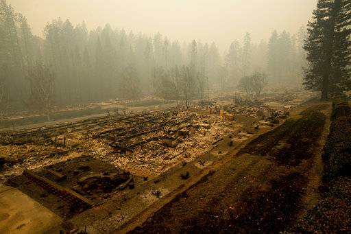 Leveled residences line a mobile home park on Edgewood Lane after the Camp Fire burned through Paradise, Calif., on Saturday, Nov. 10, 2018. Not much is left in Paradise after a ferocious wildfire roared through the Northern California town as residents fled and entire neighborhoods are leveled.