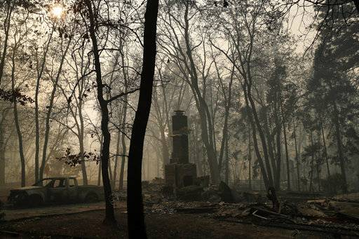 A chimney remains from a home burned in the Camp Fire, Saturday, Nov. 10, 2018, in Paradise, Calif.