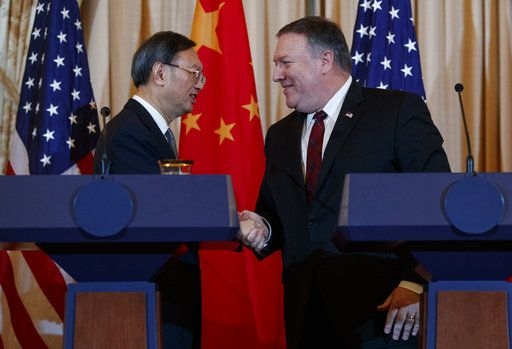 Secretary of State Mike Pompeo, right, shakes hands with Chinese Politburo Member Yang Jiechi at the conclusion of a news conference at the State Department in Washington, Friday, Nov. 9, 2018.