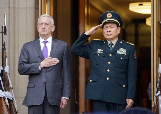 Defense Secretary Jim Mattis and Chinese Minister of Defense General Wei Fenghe, stand as the national anthems are played during an welcome ceremony at the Pentagon, Friday, Nov. 9, 2018.