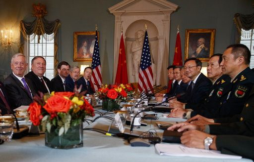 Secretary of Defense Jim Mattis, left, Secretary of State Mike Pompeo, second from left, Chinese Politburo Member Yang Jiechi, third from right, and Chinese State Councilor and Defense Minister General Wei Fenghe, second from right, meet at the State Department in Washington, Friday, Nov. 9, 2018.