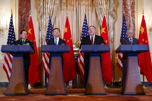 From left, Chinese State Councilor and Defense Minister General Wei Fenghe, Chinese Politburo Member Yang Jiechi, Secretary of State Mike Pompeo, and Secretary of Defense Jim Mattis, participate in a news conference at the State Department in Washington, Friday, Nov. 9, 2018.
