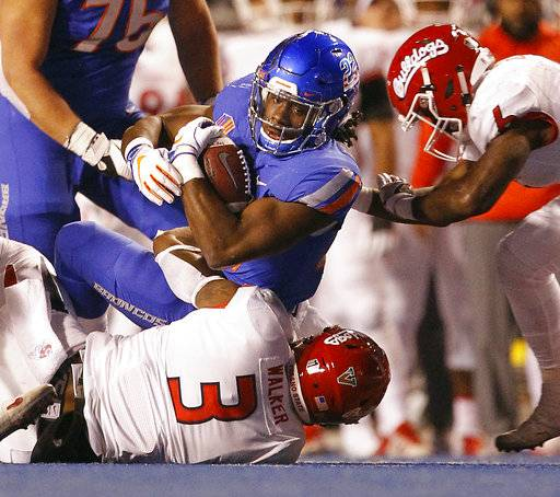 Boise State running back Alexander Mattison (22) carries the ball against Fresno State during an NCAA college football game, Friday, Nov. 9, 2018, in Boise, Idaho. (Drew Nash/The Times-News via AP)