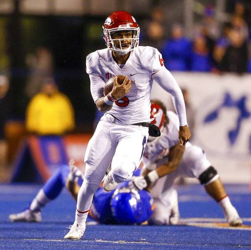 Fresno State quarterback Marcus McMaryion (6) scrambles with the ball during the first half of the team's NCAA college football game against Boise State on Friday, Nov. 9, 2018, in Boise, Idaho.