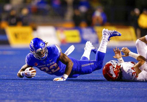 Boise State running back Alexander Mattison (22) dives for a few extra yards on a carry against Fresno State during the first half of an NCAA college football game Friday, Nov. 9, 2018, in Boise, Idaho.