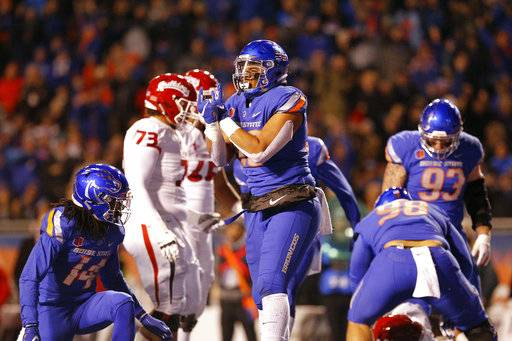 Boise State's Curtis Weaver (99) celebrates a sack and fumble against Fresno State during an NCAA college football game Friday, Nov. 9, 2018, in Boise, Idaho. (Drew Nash/The Times-News via AP)