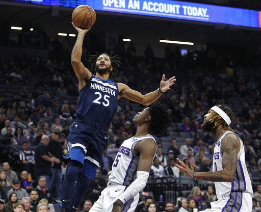 Minnesota Timberwolves guard Derrick Rose (25) shoots over Sacramento Kings guard De'Aaron Fox (5) during the first half of an NBA basketball game in Sacramento, Calif., Friday, Nov. 9, 2018.