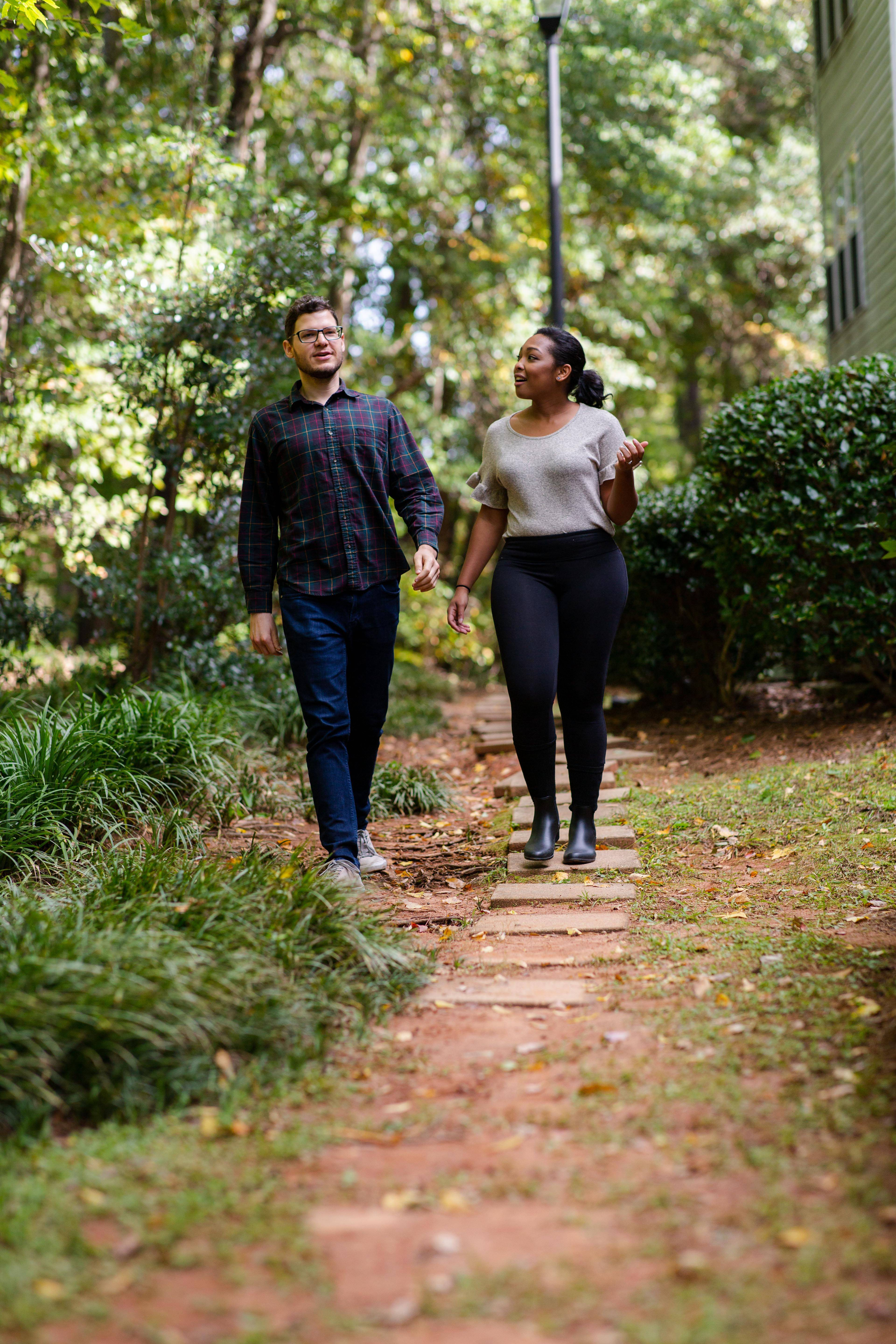 Ashley Brown and her fiance, Aaron Shuman, walk outside their condo in Atlanta.