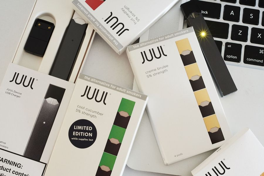 A Juul Labs Inc. e-cigarette, USB charger and flavored pods on July 8, 2018.