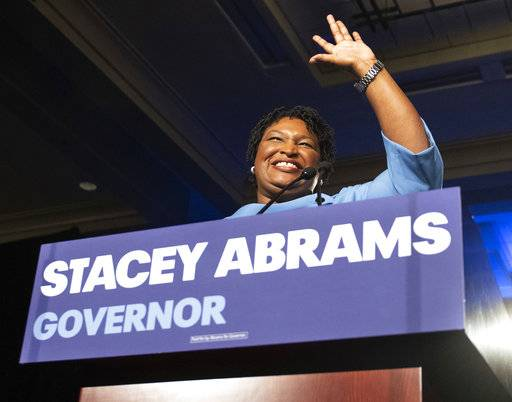 FILE - In this Nov. 6, 2018, file photo, Georgia Democratic gubernatorial candidate Stacey Abrams speaks to supporters about a suspected run-off during an election night watch party in Atlanta. For the vast majority of the nation, the 2018 midterm season is over. Yet the fight rages on in Florida and Georgia, two political battlegrounds where the strength of a Trump-era political realignment among voters by culture and class is being put to the test. Abrams hasn't conceded her race while Andrew Gillum's contest in Florida is undergoing a recount.