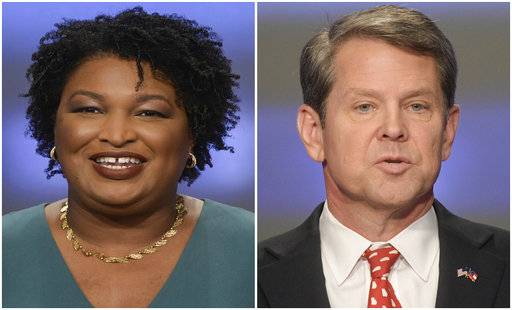 This combination of May 20, 2018, photos shows Georgia gubernatorial candidates Stacey Abrams, left, and Brian Kemp in Atlanta.  Democrats and Republicans nationwide will have to wait a bit longer to see if Georgia elects the first black woman governor in American history or doubles down on the Deep South's GOP tendencies with an acolyte of President Donald Trump