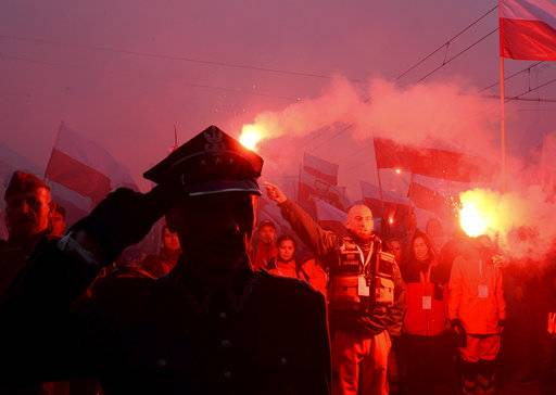 Marchers burn flares during the annual March of Independence organized by far right activists to celebrate 100 years of Poland's independence marking the nation regaining its sovereignty at the end of World War I after being wiped off the map for more than a century.