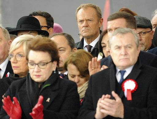 European Council President Donald Tusk, center back row, attends the official ceremony marking Poland's Independence Day, in Warsaw, Poland, Sunday, Nov. 11, 2018. Tusk joined celebrations in his native Poland on Independence Day, which celebrates the nation regaining its sovereignty at the end of World War I after being wiped off the map for more than a century.