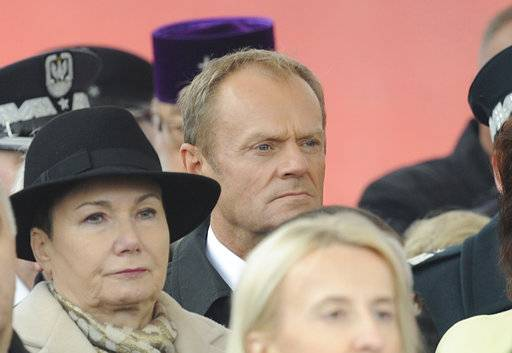 European Council President Donald Tusk, center, attends the official ceremony marking Poland's Independence Day, in Warsaw, Poland, Sunday, Nov. 11, 2018. Tusk joined celebrations in his native Poland on Independence Day, which celebrates the nation regaining its sovereignty at the end of World War I after being wiped off the map for more than a century.