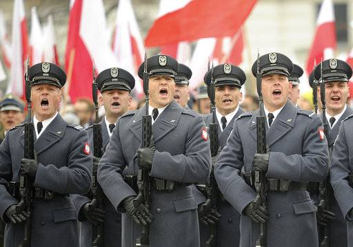 Polish Army soldiers salute during the official ceremony marking Poland's Independence Day, in Warsaw, Poland, Sunday, Nov. 11, 2018. The Independence Day in Poland celebrates the nation regaining its sovereignty at the end of World War I after being wiped off the map for more than a century.