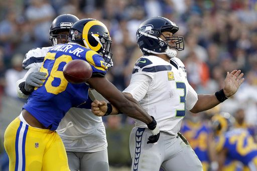 a55889d15b Rams make late defensive stand, hold off Seahawks 36-31